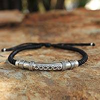 Sterling silver pendant bracelet, 'Infinite Legend in Black' - Sterling Silver and Polyester Braided Infinity Bracelet