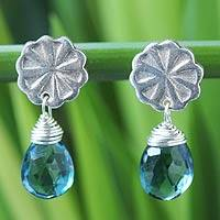 Blue topaz dangle earrings, 'Chiang Mai Daisy' - Fair Trade Sterling Silver and Blue Topaz Earrings