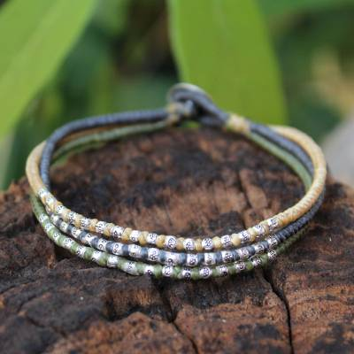 Silver accent braided bracelet, 'Thai Forest Flowers' - Silver Accent Braided Bracelet