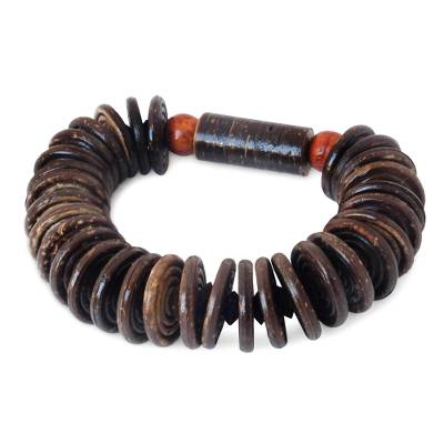 Coconut shell and wood stretch bracelet, 'Nature's Secret' - Handcrafted Coconut Shell Stretch Bracelet