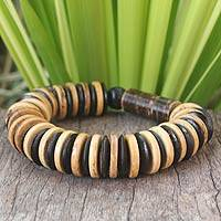 Coconut shell and wood stretch bracelet, 'Pure Nature' - Handcrafted Thai Coconut Shell and Wood Beaded Bracelet
