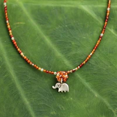 Carnelian pendant necklace, 'Elephantine Charm' - Hand Made Beaded Carnelian Necklace