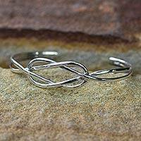 Sterling silver cuff bracelet, 'Lover's Knot' - Modern Sterling Silver Cuff Bracelet
