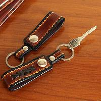 Leather key rings, 'Key to Success in Brown' (pair) - Hand Tooled Brown Leather Key Rings (Pair)