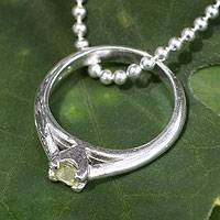 Peridot pendant necklace, 'Promise of Love' - Peridot Ring-pendant on Silver Necklace from Thailand