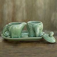 Celadon ceramic sugar and creamer set, 'Smiling Thai Elephants' - Handmade Green Celadon Ceramic Sugar Bowl and Creamer Set