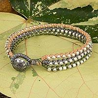 Braided wristband bracelet, 'Pastel Siam Melody' - Hill Tribe Jewelry Bracelet in Peach Gray and Green