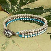 Braided wristband bracelet, 'Siam Melody' - Brown Beige and Blue Hand Made Bracelet Hill Tribe Jewelry
