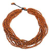 Wood torsade necklace, 'Lamphan Belle' - Orange Torsade Necklace Wood Beaded Jewelry