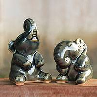 Celadon ceramic statuettes, 'Happy Dark Green Elephants' (pair)