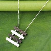 Sterling silver and wood pendant necklace, 'Nature's Balance'
