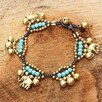 Brass charm bracelet, 'Fortune's Blue Melody' - Handcrafted Elephant and Bell Charm Bracelet from Thailand