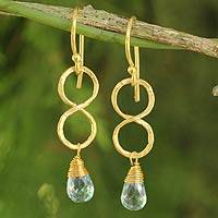 Gold plated blue topaz earrings, 'Infinity' - 24k Gold Plated Blue Topaz Dangle Earrings