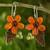 Carnelian and peridot flower earrings, 'Thai Petals' - Thai Carnelian and Peridot Beaded Flower Earrings thumbail