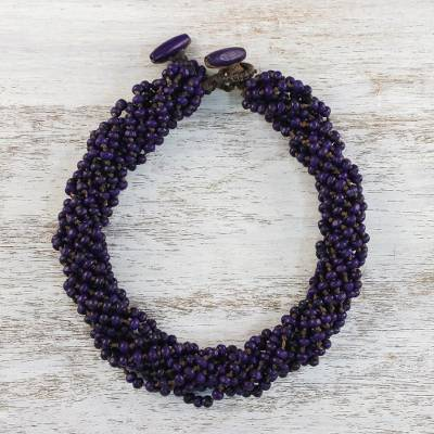 Wood torsade necklace, 'Nan Belle' - Purple Torsade Necklace Wood Beaded Jewelry