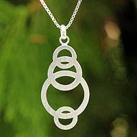 Sterling silver pendant necklace, 'Circle Dance' - Artisan Crafted Silver Geometric Necklace