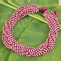 Wood torsade necklace, 'Kok Belle' - Multi-Strand Pink Beaded Wooden Necklace from Thailand