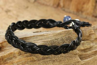 Kyanite and leather braided bracelet, 'Joyous Nature' - Braided Leather and Kyanite Bracelet with Hill Tribe Silver