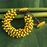 Wood torsade bracelet, 'Phrae Belle' - Wood Beaded Jewelry Yellow Torsade Bracelet