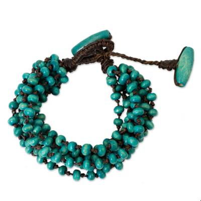 Wood torsade bracelet, 'Mekong Belle' - Blue Torsade Bracelet Wood Beaded Jewelry