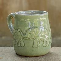 Celadon ceramic mug, 'Jade Elephant Parade' - Handcrafted Glazed Celadon Ceramic Mug (9 oz)