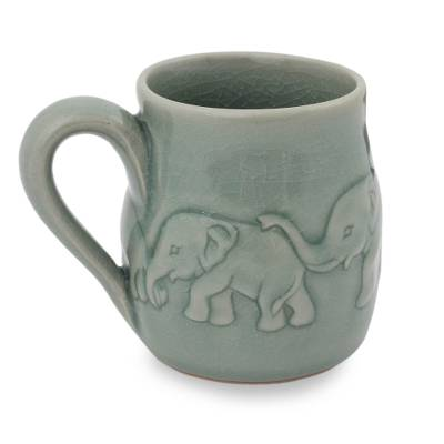 Celadon ceramic mug, 'Light Blue Elephant Parade' - Handcrafted Glazed Celadon Ceramic Mug (9 oz)