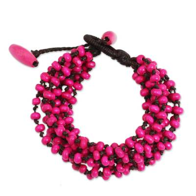 Wood beaded bracelet, 'Opulent Pink' - Hot Pink Hand Knotted Beaded Bracelet