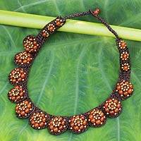 Carnelian beaded flower necklace, 'Daisy Melody' - Carnelian and Brass Hand Crocheted Necklace