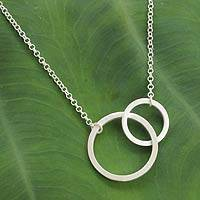 Sterling silver two circle pendant necklace, 'Together' - Fair Trade Sterling Silver Thai Two Circle Necklace