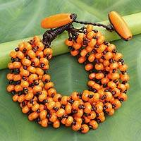 Wood beaded bracelet, 'Lamphan Belle' - Orange Torsade Bracelet Wood Beaded Jewelry