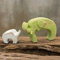 Wood sculpture, 'Green Elephant Family' (pair) - Hand Crafted Green and White Wood Elephant Sculptures (Pair)