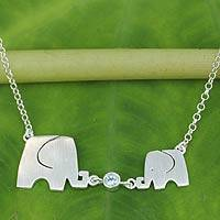 Blue topaz pendant necklace, 'Family Love' - Sterling Silver Elephant Necklace