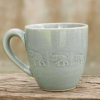 Celadon ceramic mug, 'Blue Elephant Walk' - Celadon Ceramic Elephant Mug from Thailand