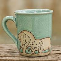Celadon ceramic mug, 'Blue Elephant Family' - Blue and Brown Elephant Theme Celadon Ceramic Mug