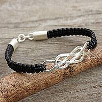 Leather pendant bracelet, 'Infinite Wonder' - Thai Sterling Silver and Hand Knotted Leather Bracelet