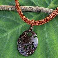 Coconut shell pendant necklace, 'Thai Phoenix in Brown' - Coconut Shell Phoenix Pendant Necklace with Leather Cord