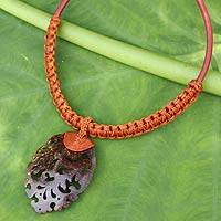 Coconut shell pendant necklace, 'Elegant Thailand in Rust' - Coconut Shell Necklace on Leather and Macrame Cords