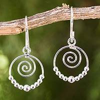 Sterling silver dangle earrings, 'Whirl' - Handcrafted Sterling Silver Dangle Earrings with Spirals