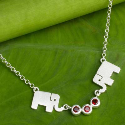 Garnet pendant necklace, 'Joyful Elephant' - Brushed Silver Elephant Pendant Necklace with Garnets