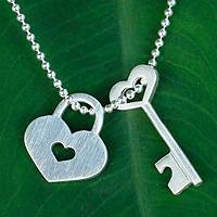 Sterling silver pendant necklace, 'Key of Love' - Handcrafted Silver Heart  Lock and Key Pendant Necklace