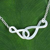 Sterling silver pendant necklace, 'Into Infinity' - Brushed Sterling Silver Necklace with Infinity Symbols