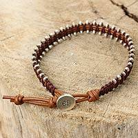 Silver and leather wristband bracelet, 'Hill Tribe Bouquet' - Florid Silver Beads on Hand Crafted Brown Leather Bracelet