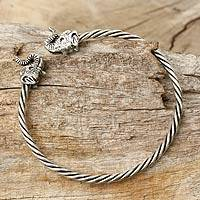 Sterling silver cuff bracelet, 'Elephant Meeting' - Twisted Thai Silver Bangle with Twin Elephant Motifs