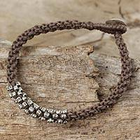 Silver beaded cord bracelet, 'Tribal Flowers in Taupe' - Braided grey Cord Bracelet with Silver 950 Floral Beads