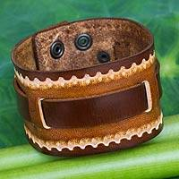Men's leather wristband bracelet, 'Western Quest' - Hand Tooled Brown Leather Bracelet for Men
