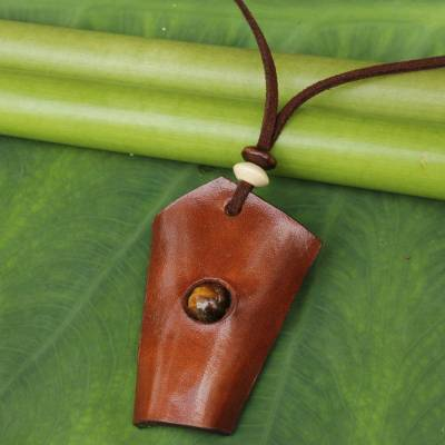 Tiger's eye and leather pendant necklace, 'Amulet' - Handmade Leather Necklace with Tiger's Eye and Wood Beads