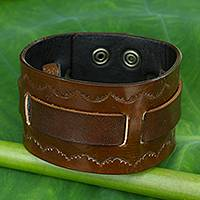 Men's leather wristband bracelet, 'Western Brown' - Hand Tooled Brown Leather Wristband Bracelet for Men