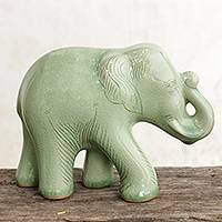Celadon ceramic figurine, 'Smiling Elephant' - Celadon Ceramic Happy Elephant Figurine by Thai Artisans