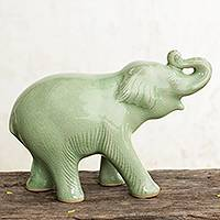 Celadon ceramic figurine, 'Laughing Elephant' - Thai Artisan Crafted Celadon Ceramic Elephant Figurine