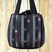 Cotton shoulder bag, 'Orient Black' - Dark Ikat Style Hand Woven Cotton Shoulder Bag with Pockets